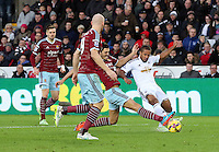 Pictured: Wayne Routledge of Swansea (R) is tackled by a West Ham player Saturday 10 January 2015<br />