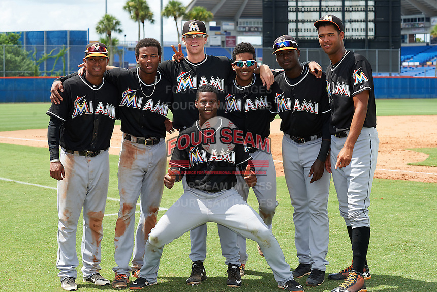 GCL Marlins (L-R) Jhonny Santos, Garvis Lara, Chris Paddack, Pablo Garcia, Javier Lopez, Aneury Osoria and Samuel Castro (front) after the first game of a doubleheader against the GCL Mets on July 24, 2015 at the St. Lucie Sports Complex in St. Lucie, Florida.  GCL Marlins defeated the GCL Mets 5-4.  (Mike Janes/Four Seam Images)