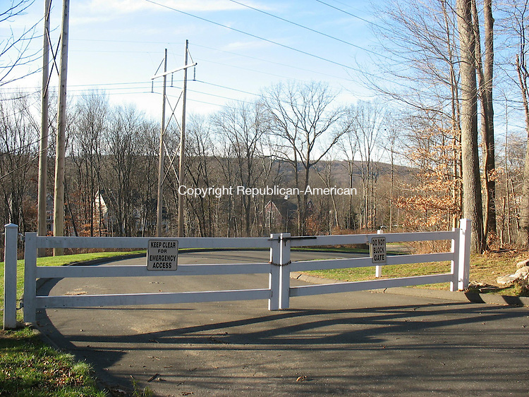 SOUTHBURY, CT. - 24 Nov. 2010 - 112410CG02 - Southbury Fire Marshal Henry Stormer has ordered this gate on East Hill Road in Southbury closed from Dec. 1 through April 1 so emergency vehicles can pass. The gate separates Traditions at Historic Southbury from Heritage Village. Chris Gardner Republican-American