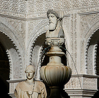 Detail of the courtyard with fountain statue and a Roman statue of Minerva in the background, Central Patio, Casa de Pilatos (Pilate's House), Seville, Spain, pictured on December 30, 2006, in the afternoon. Pilate's House, late 15th century, was built by the Enriquez and Ribera families During the 16th century these families, who had a strong relationship with Italy,  introduced the Renaissance style to Seville. In the palace is the sculpture collection of the Duke of Alcala  who brought back many Classical pieces from Italy and adapted the palace and gardens to exhibiting them in Renaissance style. The buildings were further modified according to Romantic taste in the 19th century and now present a combination of Mudejar-Gothic, Renaissance and Romantic styles. Today the Casa de Pilatos belongs to the Fundacion Casa Ducal de Medicaneli and is the residence of the Dukes of Medicaneli. Picture by Manuel Cohen.