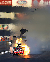 Nov 9, 2013; Pomona, CA, USA; NHRA top fuel dragster driver Todd Paton blows an engine in flames during qualifying for the Auto Club Finals at Auto Club Raceway at Pomona. Mandatory Credit: Mark J. Rebilas-USA TODAY Sports