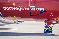 "An aircraft ""mothballed"" as it is grounded due to the coronoa crisis. <br /> <br /> Norwegian authorites introduced measures to combat the Coronavirus (COVID-19)  leaving Gardermoen Airport, near the Norwegian capital Oslo, deserted. <br /> <br /> Restriction on public gatherings and travel have grounded most airplanes, and stopped nearly all domestic and foreign travel. <br /> <br />  Like most capitals, Oslo is usually busy on a Saturday night. But on the first weekend after Norwegian authorites introduced measures to combat the Coronavirus (COVID-19) the city was almost deserted. <br /> <br /> Restriction on public gatherings, closure of schhols, new rules for those serving food and drinks, and fear of further spread of the virus compelled most bars and restaurants to close. <br /> <br /> 28,5 million passangers used the airport in 2018, with the airline Norwegian flying the most people. At teh time of writing Norweigan is on the verge of bankruptcy, and hoping to get governemnt aid to surive the economic crisis caused by the corona virus.  <br /> <br /> <br /> ©Fredrik Naumann/Felix Features"