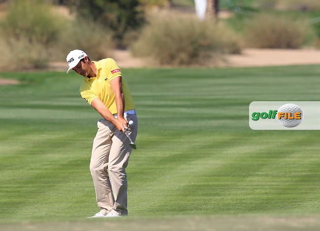 Julien QUESNE (FRA) chips onto the 10th green during Thursday's Round 1 of the 2015 Omega Dubai Desert Classic held at the Emirates Golf Club, Dubai, UAE.: Picture Eoin Clarke, www.golffile.ie: 1/29/2015