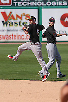 Quad Cities River Bandits second baseman Alex Hernandez (6) jumps in the air to make a throw to first base as shortstop shortstop Thomas Lindauer (1) backs up the play during a game against the Wisconsin Timber Rattlers on May 2nd, 2015 at Fox Cities Stadium in Appleton, Wisconsin.  Quad Cities defeated Wisconsin 5-2.  (Brad Krause/Four Seam Images)