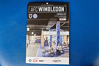 The front cover of the programme with an artist's impression of part of the fan's zone at the new stadium during AFC Wimbledon vs Rochdale, Sky Bet EFL League 1 Football at the Cherry Red Records Stadium on 5th October 2019