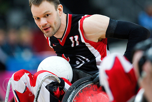 18 APR 2012 - LONDON, GBR - Canadian Fabien Lavoie (CAN) (Class 3.0) looks for a way through the Australian defence during their  London International Invitational Wheelchair Rugby Tournament match at the Olympic Park Basketball Arena in Stratford, London, Great Britain  (PHOTO (C) 2012 NIGEL FARROW)