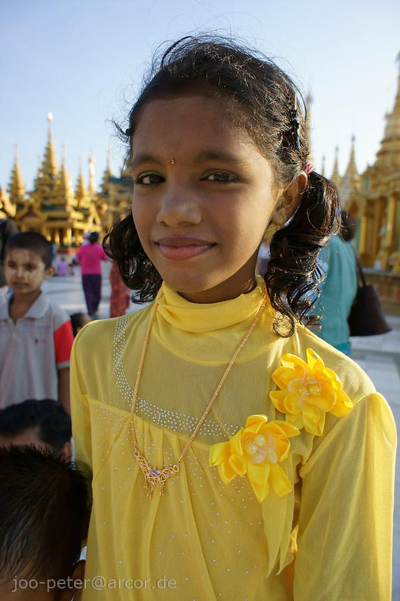 girl in yellow dress visiting Shwedagon pagoda complex, Yangon, Myanmar, 2011