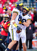College Park, MD - NOV 11, 2017: Michigan Wolverines tight end Zach Gentry (83) celebrates a touchdown with teammate Wolverines wide receiver Maurice Ways (85) during game between Maryland and Michigan at Capital One Field at Maryland Stadium in College Park, MD. (Photo by Phil Peters/Media Images International)