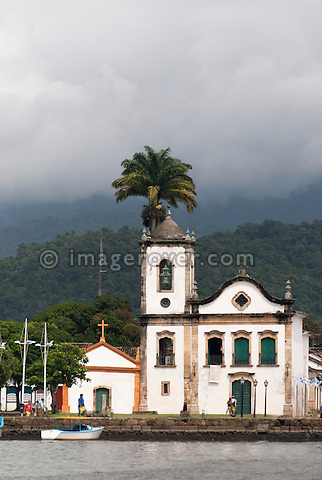 Paraty's oldest church, the Nossa Senhora dos Pardos Libertos (built 1722); Paraty, Espirito Santo, Brazil. --- Info: The beautiful colonial town of Paraty has been a UNESCO World Heritage Site since 1958. Very charming the whitewashed churches and terra-cotta roofs contrast the lush green of the rainforest-clad mountains. --- No signed releases available.