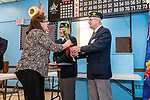NAUGATUCK, CT. 08 December 2018-120818 -  Linda Kazimir is given one single red rose from Sergeant of Arms Ron Fischer, right, as chaplain Bill Detlefsen looks on  during the honoring of Vietnam Veterans Spouses, part of the Certificate of Honor Program at the American Legion Post 17 in Naugatuck on Saturday. This is the first time in Connecticut that any type of honor has been given to the spouses. Bill Shettle Republican-American