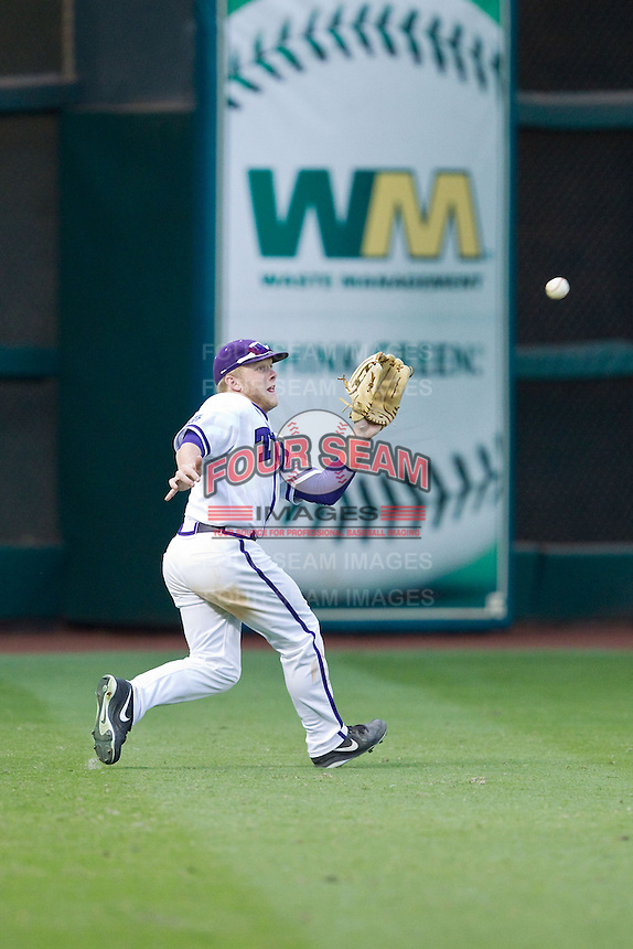 Texas Christian Horned Frogs left fielder Boomer White #8 tracks down a fly ball during the game against the Sam Houston State Bearkats at Minute Maid Park on February 28, 2014 in Houston, Texas.  The Bearkats defeated the Horned Frogs 9-4.  (Brian Westerholt/Four Seam Images)