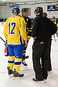 Gabriel Landeskog (Sweden - 12), Adam Ross (Merrimack - 26) meet with the officials. - The Merrimack College Warriors defeated the visiting Sweden Under 20 team 4-1 on Tuesday, November 2, 2010, at Lawler Arena in North Andover, Massachusetts.