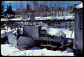 A side-view of drag flanger #OL (?) in snowy Chama yard.<br /> C&amp;TS  Chama, NM  prior to 2/1978
