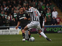 Beram Kayal tackled by Lee Mair in the St Mirren v Celtic Clydesdale Bank Scottish Premier League match played at St Mirren Park, Paisley on 20.10.12.