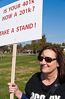"Beverley holds a ""Is your 401K now a 201k?  Take a stand!"" sign during the Occupy Orange County, Irvine march on November 5."