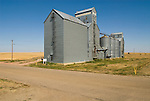Metal grain elevator by former railroad grade