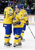 Daniel Brodin (Sweden - 26), Mattias Tedenby (Sweden - 9) - Team Sweden celebrates after defeating Team Switzerland 11-4 to win the bronze medal in the 2010 World Juniors tournament on Tuesday, January 5, 2010, at the Credit Union Centre in Saskatoon, Saskatchewan.