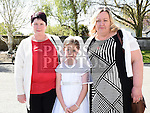 Gracie Mangan who received her first holy communion in St Brigid's church Dunleer pictured with her two grandmothers Una Dunne and Judith Mangan. Photo:Colin Bell/pressphotos.ie