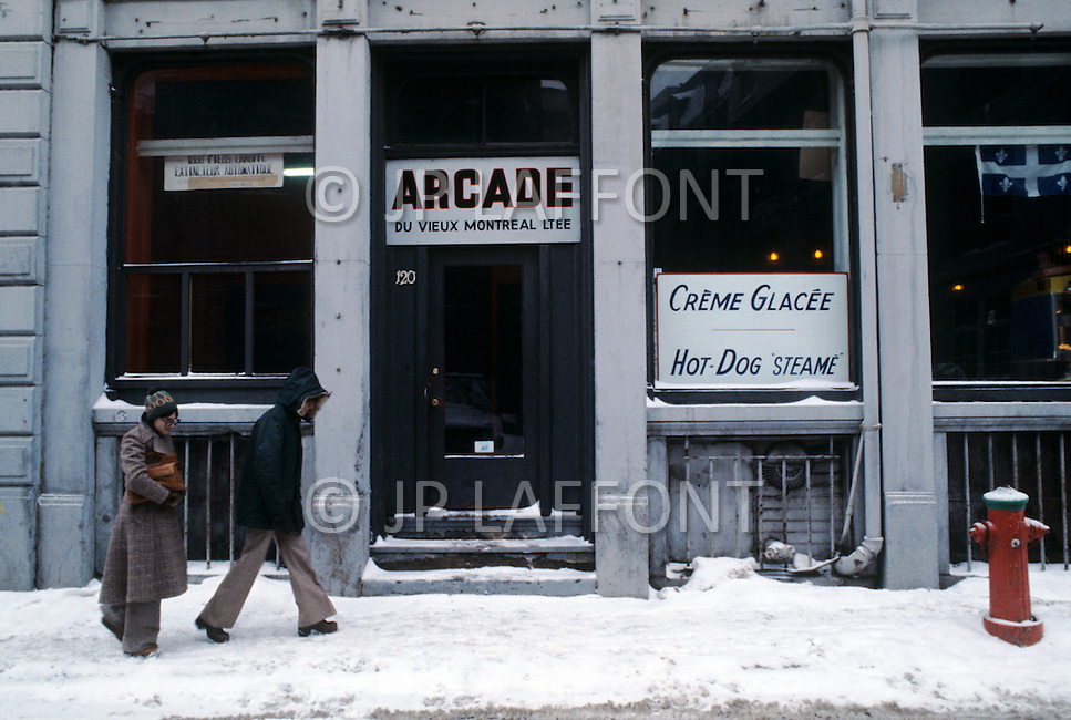 Montreal, Canada, March 1978. The streets in Winter. Bilingual Signs.