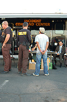 "Phoenix, Arizona. March 29, 2008 - The Maricopa County Sheriff's Office (MCSO) led by Sheriff Joe Arpaio conducted what they called the ""Bell Road Crime Suppression,"" a two-day operation consisting of saturation patrol in the area of Bell Road and Cave Creek Road, in north Phoenix. According to MCSO, during the two-day crime suppression operation, sheriff's deputies and posse members arrested a total of 53 suspects who were taken into custody, 27 of which were reportedly illegally in the country. The remaining 26 arrests were U.S. citizens. The MCSO set their command center in the parking lot of a strip mall. People from the surrounding community, immigration advocates and organizers protested the sheriff's operation around the perimeter restricted by MCSO by yelling and display signs with a variety of messages against MCSO and Arpaio. Supporters of Sheriff Arpaio were also present at the protest. Both groups of protesters engaged in verbal confrontations. For activists, MCSO's ""crime suppression"" operations are nothing but ""immigration raids,"" where according to immigrant's advocates MCSO posse members and sheriff deputies engage in racial profiling to target and stop Latino motorists based on physical appearance features such as brown skin. Photo by Eduardo Barraza © 2008"