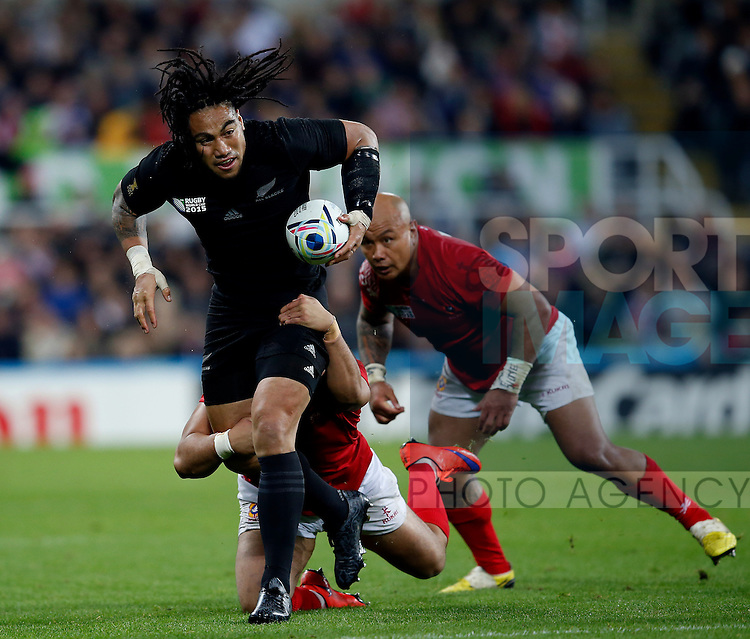 Ma'a Nonu of New Zealand tackled by Soane Tonga'uiha and Viliami Tahitu'a of Tonga - Rugby World Cup 2015 - Pool C - New Zealand vs Tonga - St James' Park Stadium - Newcastle - England - 9th October 2015 - Picture Simon Bellis/Sportimage