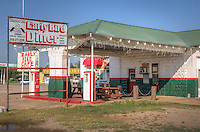 The Early Bird Diner on Route 66 in Davenport Oklahoma is in a restored 1933 Texaco filling station at 7th and Broadway that has an awning complete with recessed tin ceiling. One of the bay doors is covered with collectible license plates from the 1920s and 1930s.