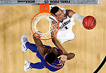 SAN ANTONIO, TX - MARCH 31: Jalen Brunson #1 of the Villanova Wildcats drives to the basket against Silvio De Sousa #22 of the Kansas Jayhawks during the 2018 NCAA Men's Final Four Semifinal at the Alamodome on March 31, 2018 in San Antonio, Texas.  (Photo by Ronald Martinez/Getty Images)