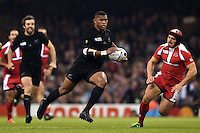 Waisake Naholo of New Zealand goes on the attack. Rugby World Cup Pool C match between New Zealand and Georgia on October 2, 2015 at the Millennium Stadium in Cardiff, Wales. Photo by: Patrick Khachfe / Onside Images