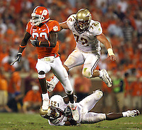 Clemson's Aaron Kelly hurdles Florida State's Michael Ray Garvin as Budd Thacker pursues during a 41-yard touchdown completion in the second quarter.