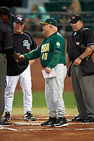 Siena Saints head coach Tony Rossi (40) shakes hands with third base umpire Arthur Thigpen during the lineup exchange as Pete Dunn and home plate umpire Ray Parrish look on before a game against the Stetson Hatters on February 23, 2016 at Melching Field at Conrad Park in DeLand, Florida.  Stetson defeated Siena 5-3.  (Mike Janes/Four Seam Images)
