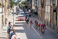 breakaway group rolling through town<br /> <br /> Stage 14: San Vicente de la Barquer to Oviedo (188km)<br /> La Vuelta 2019<br /> <br /> ©kramon