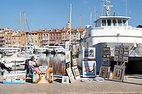 Artist displaying their work, St Tropez port, St Tropez, France, 23 February 2009