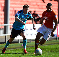 Fleetwood Town's Ashley Hunter competes with Blackpool's Colin Daniel<br /> <br /> Photographer Richard Martin-Roberts/CameraSport<br /> <br /> The EFL Sky Bet League One - Blackpool v Fleetwood Town - Saturday 14th April 2018 - Bloomfield Road - Blackpool<br /> <br /> World Copyright &not;&copy; 2018 CameraSport. All rights reserved. 43 Linden Ave. Countesthorpe. Leicester. England. LE8 5PG - Tel: +44 (0) 116 277 4147 - admin@camerasport.com - www.camerasport.com