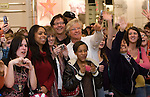031409tvhelloparis.Fans wave at Paris Hilton at Macy's..BND/TIM VIZER