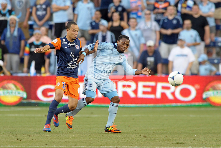 Korde Aiyegbusi (3) forward Sporting KC holds off Karim Alt Fana (18) forward Montpellier..Sporting Kansas City were defeated 3-0 by Montpellier HSC in an international friendly at LIVESTRONG Sporting Park, Kansas City, KS..