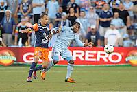 Korde Aiyegbusi (3) forward Sporting KC holds off Karim Alt Fana (18) forward Montpellier..Sporting Kansas City were defeated 3-0 by Montpellier HSC in an international friendly at LIVESTRONG Sporting Park, Kansas City, KS..