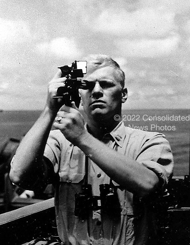 Ann Arbor, MI - FILE --  Navigation Officer Gerald R. Ford takes a sextant reading aboard the USS MONTEREY. Date: 1944<br /> Credit: Courtesy Gerald R. Ford Library via CNP