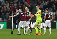 West Ham United's James Collins confronts a pitch invader<br /> <br /> Photographer Rob Newell/CameraSport<br /> <br /> The Premier League - West Ham United v Burnley - Saturday 10th March 2018 - London Stadium - London<br /> <br /> World Copyright &not;&copy; 2018 CameraSport. All rights reserved. 43 Linden Ave. Countesthorpe. Leicester. England. LE8 5PG - Tel: +44 (0) 116 277 4147 - admin@camerasport.com - www.camerasport.com