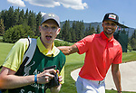 Steph Curry jokes with his cady during the American Century Championship at Edgewood Tahoe Golf Course in Stateline, Nevada, Saturday, July 14, 2018.