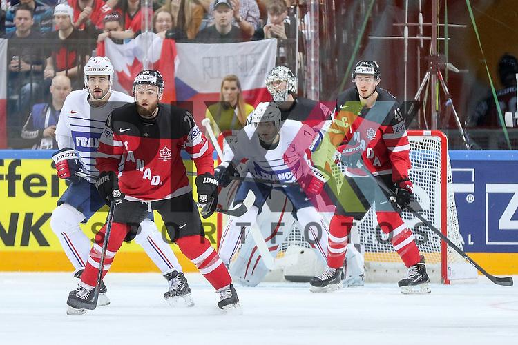 Canadas O'Reilly, Ryan (Nr.79) und Canadas Wiercioch, Patrick (Nr.46) helfen in der Abwehr gegen Frankreichs Treille, Yorick (Nr.7) und Frankreichs Treille, Sacha (Nr.77)  im Spiel IIHF WC15 France vs Canada.<br /> <br /> Foto &copy; P-I-X.org *** Foto ist honorarpflichtig! *** Auf Anfrage in hoeherer Qualitaet/Aufloesung. Belegexemplar erbeten. Veroeffentlichung ausschliesslich fuer journalistisch-publizistische Zwecke. For editorial use only.