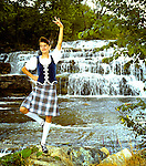 Young girl Highland dancer scot, scottish, traditional, culture, outdoor, river, waterfall, vertical, hobby, tartan, kilt, canada