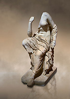 Roman statue of a seated woman . Marble. Perge. 2nd century AD. Inv no 17.7. . Antalya Archaeology Museum; Turkey. Against a warm art background.