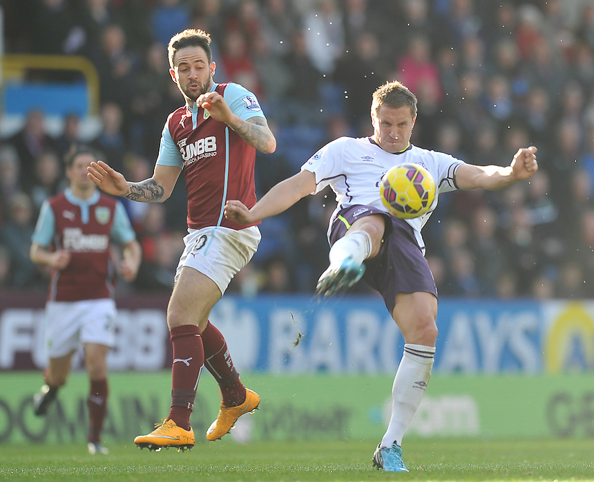 Everton's Phil Jagielka beats Burnley's Danny Ings to the ball<br /> <br /> Photographer Dave Howarth/CameraSport<br /> <br /> Football - Barclays Premiership - Burnley v Everton - Sunday 26th October - Turf Moor - Burnley<br /> <br /> &copy; CameraSport - 43 Linden Ave. Countesthorpe. Leicester. England. LE8 5PG - Tel: +44 (0) 116 277 4147 - admin@camerasport.com - www.camerasport.com