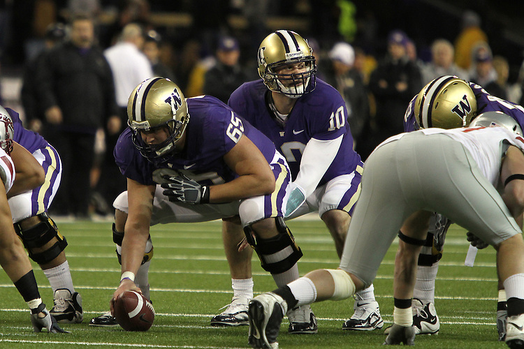 Jake Locker (#10), University of Washington quarterback, calls out the signals at the line of scrimmage during the Huskies Pac-10 conference football game against arch-rival Washington State at Husky Stadium in Seattle, Washington, on November 28, 2009.  Washington shut out the Cougars in their annual Apple Cup battle, 30-0.