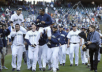 04 October 2009: Seattle Mariners players carry #51 Ichiro Suzuki and #24 Ken Griffey Jr off the field after the helped defeat the Texas Rangers. Seattle won 4-3 over the Texas Rangers at Safeco Field in Seattle, Washington.