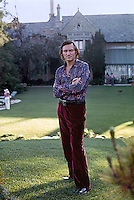 Hugh Hefner poses in front of the Playboy Mansion, Los Angeles, 1973. Photo by John G. Zimmerman.
