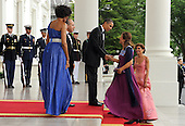 United States President Barack Obama greets Mexican First Lady Margarita Zavala as he and First Lady Michelle Obama welcome Mexican President Felipe Calderon and Ms. Zavala on the North Portico of the White House for a State Dinner in Washington on Wednesday, May 19, 2010.   .Credit: Roger L. Wollenberg - Pool via CNP