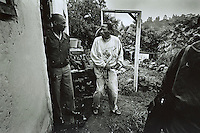 PORT SHEPSTONE, SOUTH AFRICA - JANUARY 25: An unidentified rape suspect (R) is arrested by an officer of the Child Protection Unit, a special police unit that deals with abuse against children in the early hours within a black township January 25, 2002 outside Port Shepstone, in Southern Natal, South Africa. The suspect is alleged to have raped his daughter. The South African police had about 22,000 reported cases of child rape or attempted rape in 2001. Baby Thsepang, an eight-month-old baby, was brutally raped by her father in October 2001 in Loisevale, a poor black area outside Upington, which is located approximately 560 miles Northwest of Cape Town, South Africa. The country is struggling with an increasing number of rapes and sexual abuse of young children. In addition, the country has the highest number of rapes in the world. (Photo by Per-Anders Pettersson)