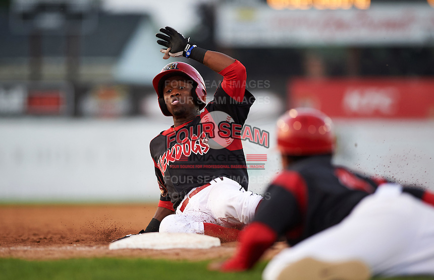 Batavia Muckdogs shortstop Anfernee Seymour (3) slides into third during a game against the West Virginia Black Bears on August 30, 2015 at Dwyer Stadium in Batavia, New York.  Batavia defeated West Virginia 8-5.  (Mike Janes/Four Seam Images)