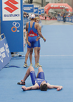 31 AUG 2007 - HAMBURG, GER - Alistair Brownlee (GBR) recovers after finishing second whilst Vincent Luis (facing) congratulates French teammate Aurelien Raphael on his victory - Junior Mens World Triathlon Championships. (PHOTO (C) NIGEL FARROW)